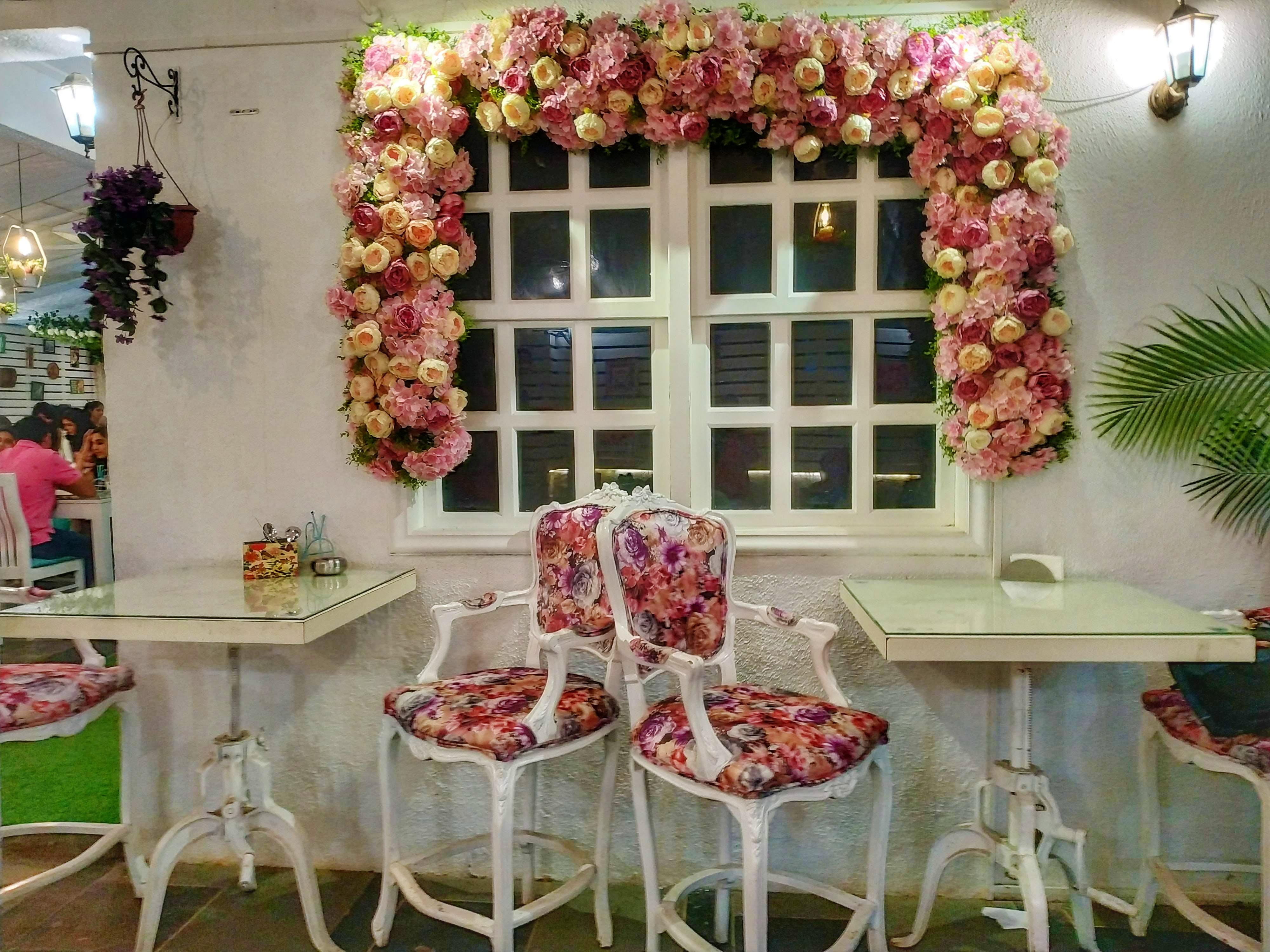 Pink,Architecture,Interior design,Room,Table,Arch,Flower,Plant,Furniture,Textile