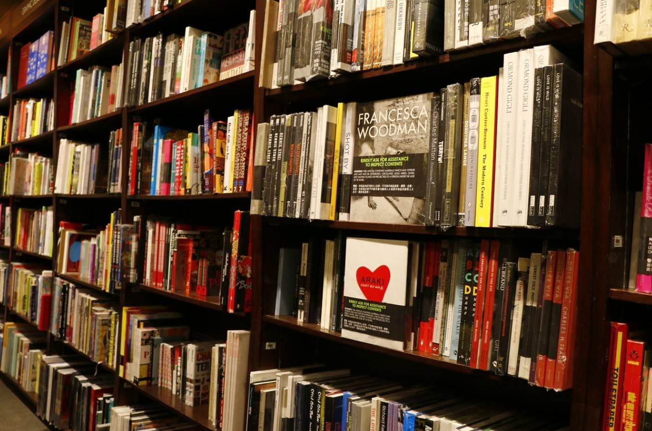 Bookcase,Shelving,Library,Shelf,Book,Publication,Bookselling,Public library,Furniture,Building
