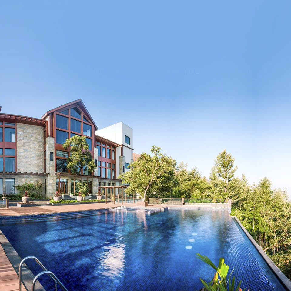 Swimming pool,Property,Real estate,Resort,Building,House,Architecture,Sky,Leisure,Water