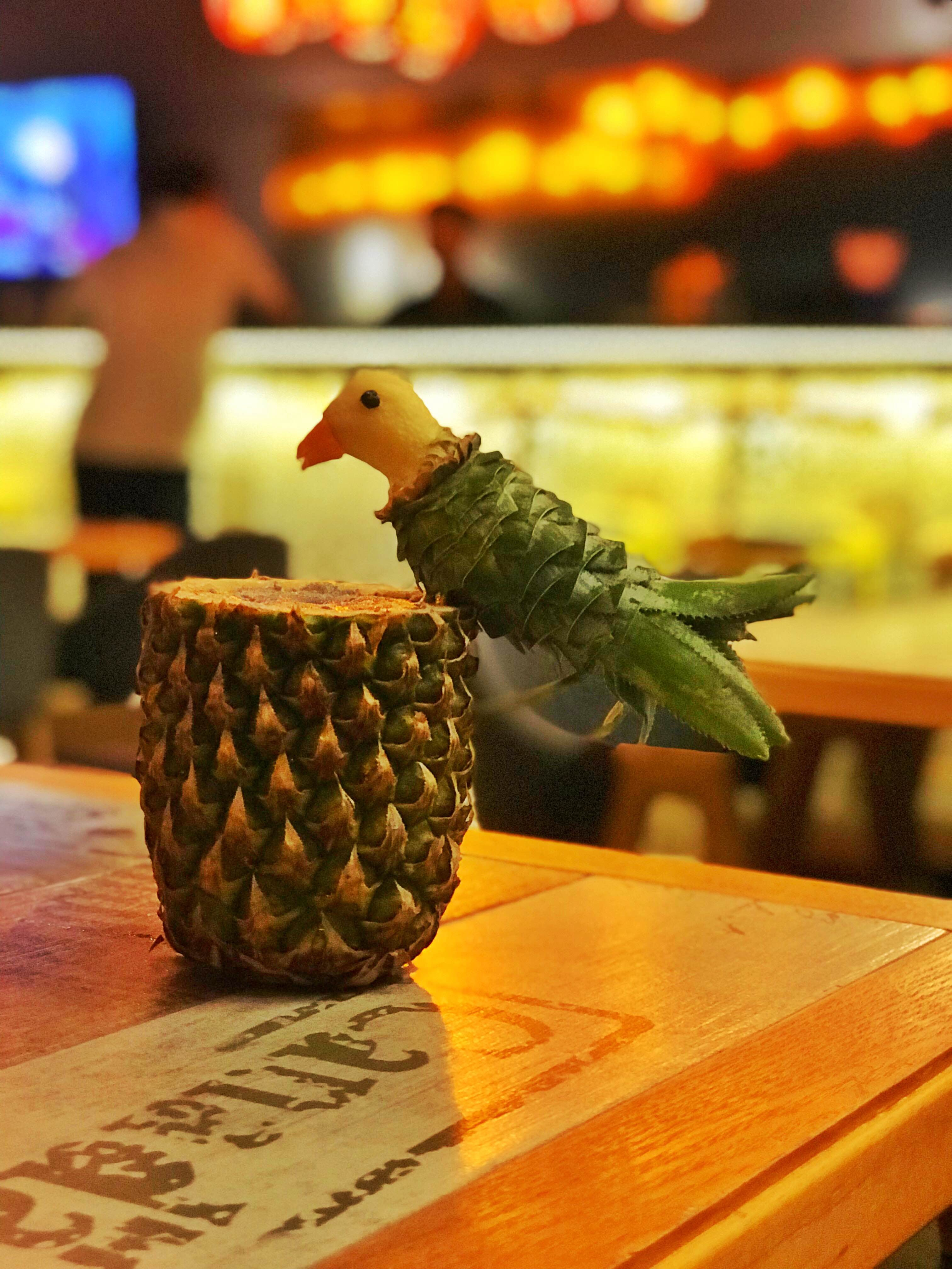 Pineapple,Ananas,Plant,Conifer cone,Table,Bird,Fruit,Barware