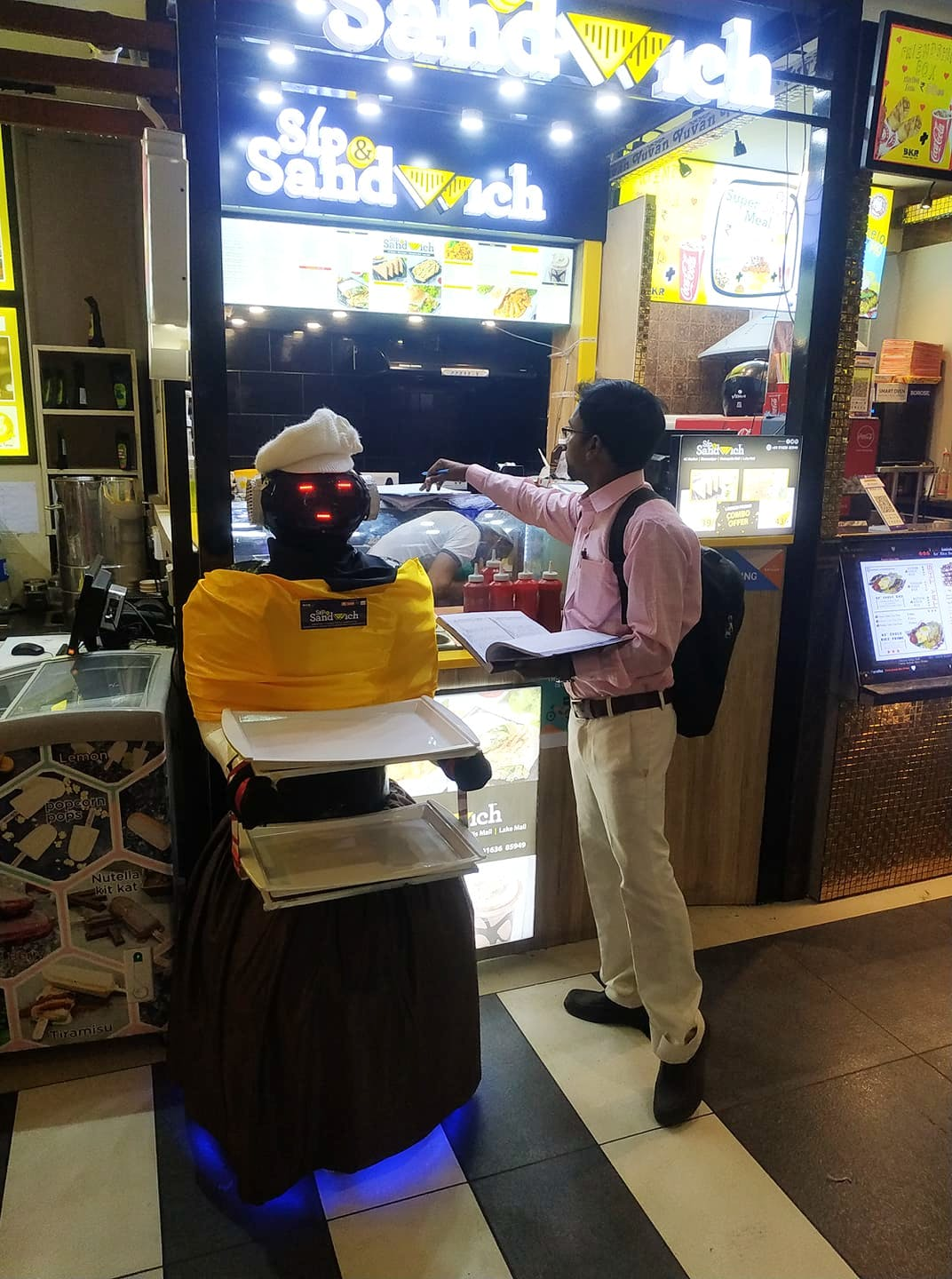 Yellow,Games,Fast food restaurant,Technology,Electronic device,Machine,Recreation,Fast food,Arcade game,Tourism