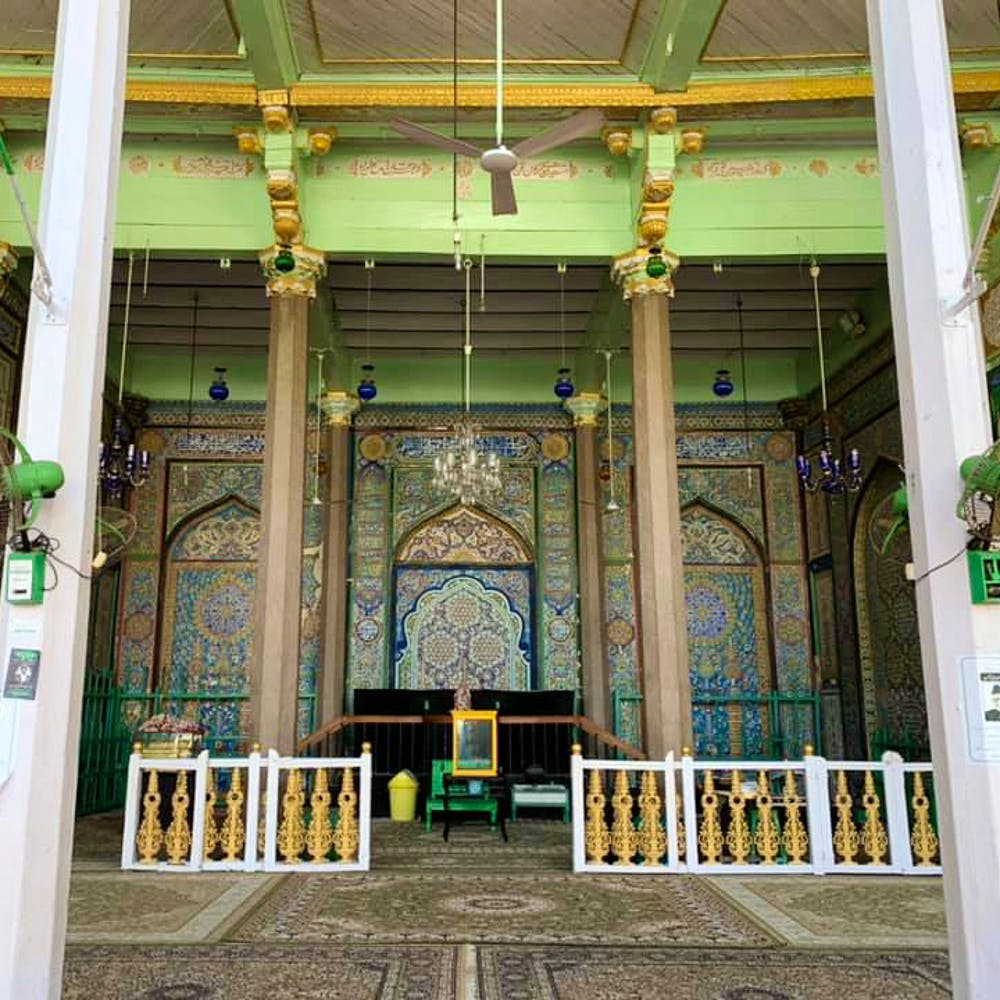 Building,Architecture,Shrine,Column,Tree,Place of worship,Symmetry,Door,Plant,Ceiling