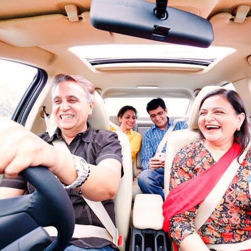 Vehicle,Car seat,Transport,Luxury vehicle,Car,Passenger,Family car,Fun,Auto part,Vacation