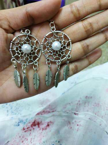 Jewellery,Fashion accessory,Body jewelry,Hand,Finger,Earrings,Silver,Turquoise,Pearl,Gemstone