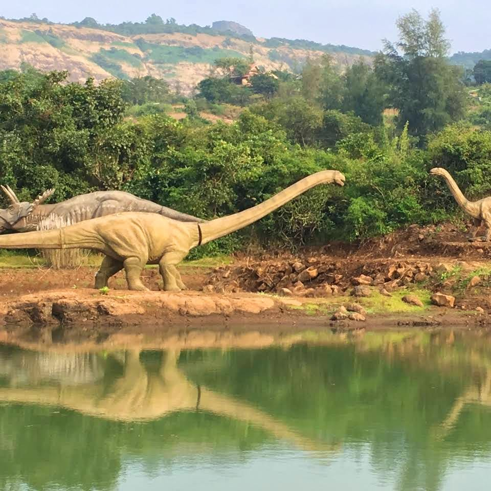 Dinosaur,Water,Water resources,Bank,Nature reserve,Vegetation,Wildlife,Terrestrial animal,Natural landscape,Natural environment