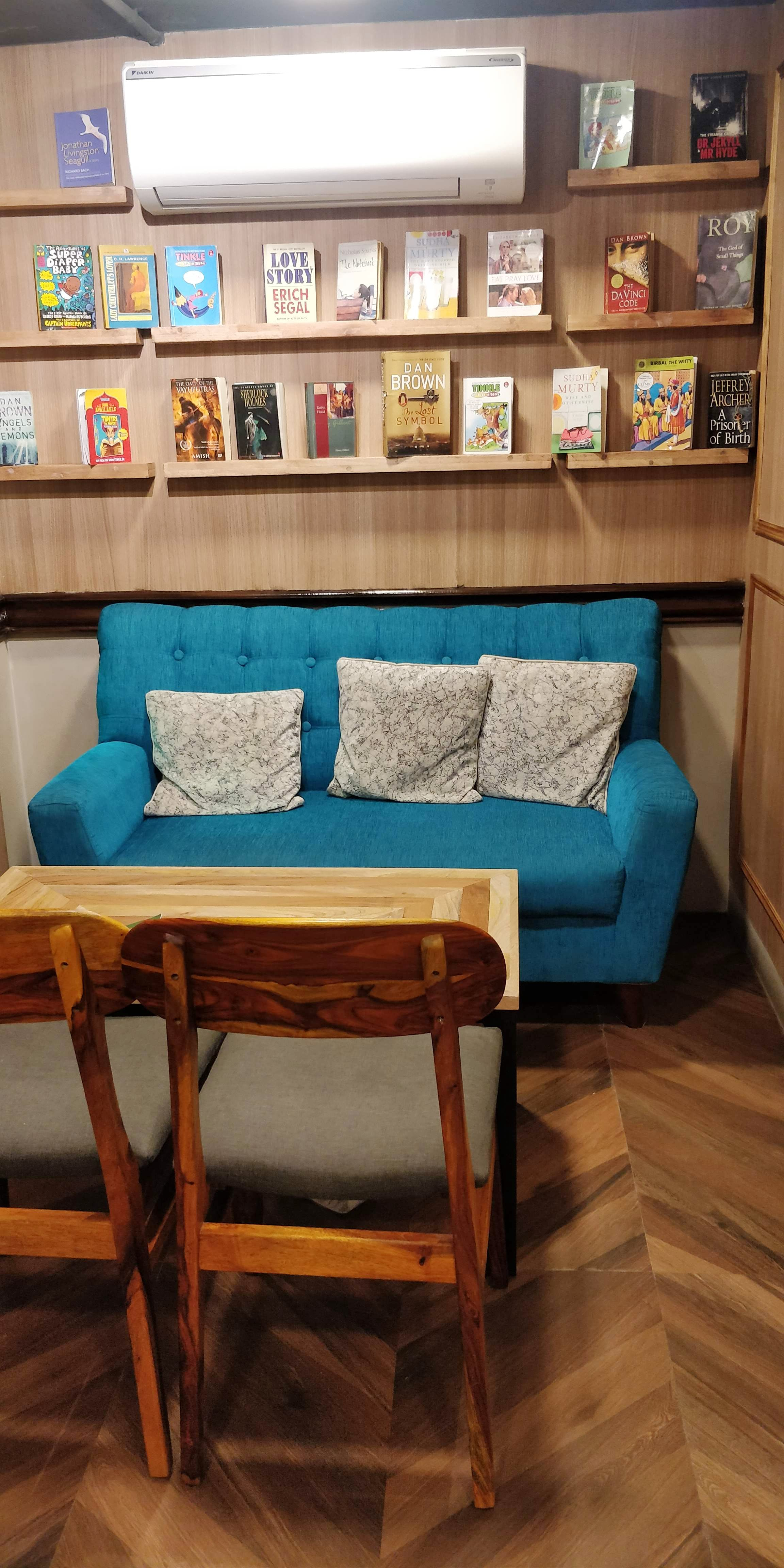 Furniture,Room,Table,Interior design,Living room,Floor,Turquoise,Couch,Hardwood,Coffee table