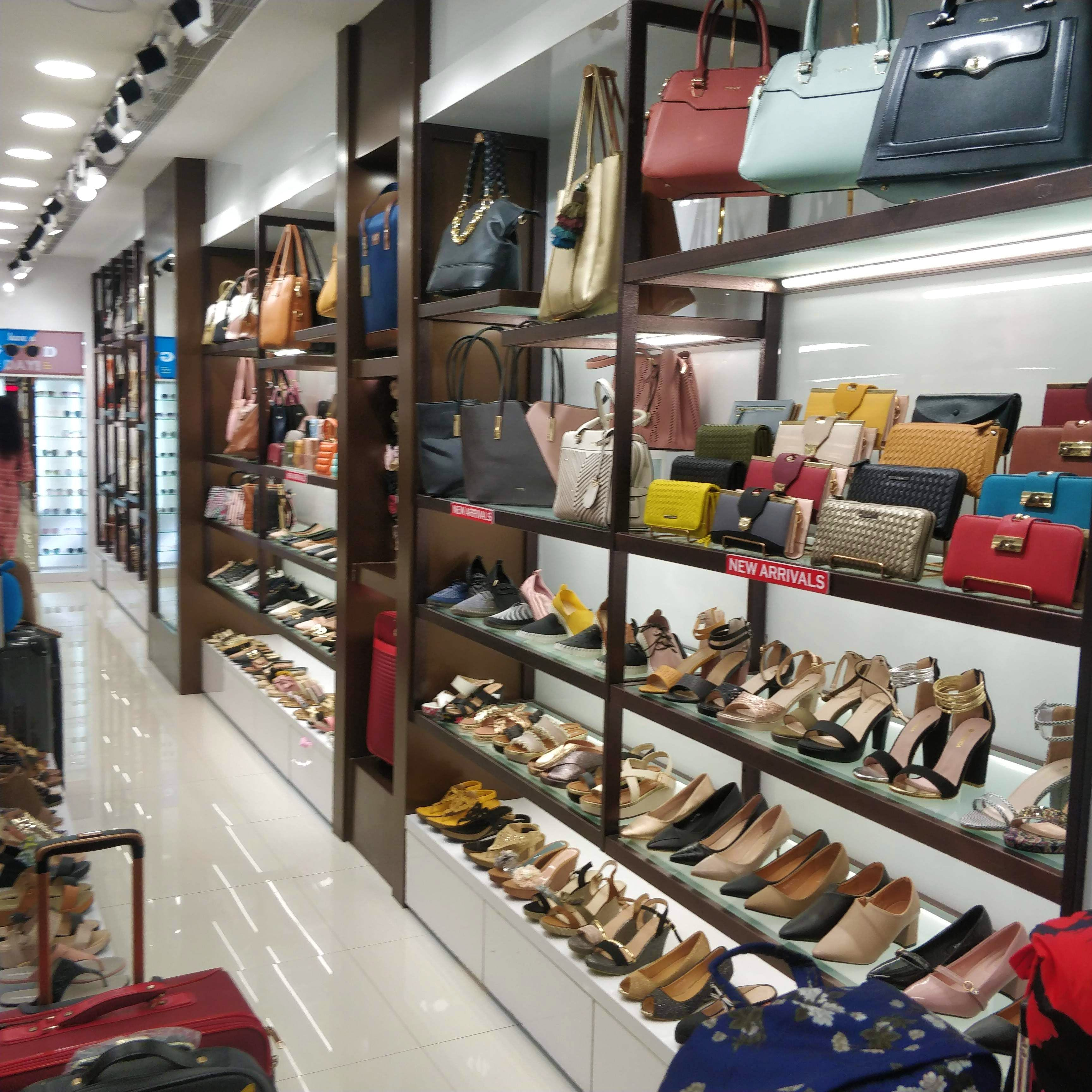 Outlet store,Building,Footwear,Retail,Inventory,Shoe store,Collection,Shoe,Interior design,Display case