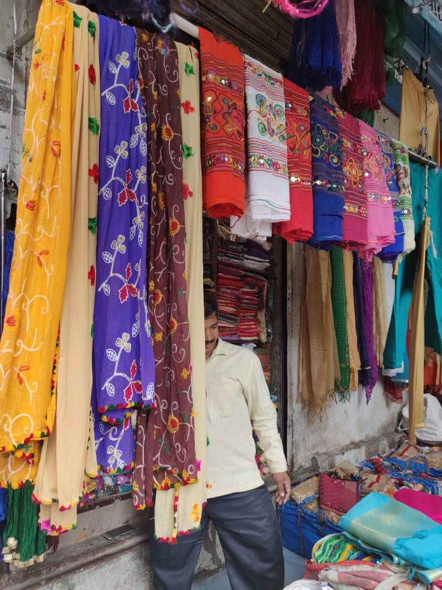 Market,Bazaar,Selling,Public space,Marketplace,Textile,Human settlement,Boutique,Flea market,Room