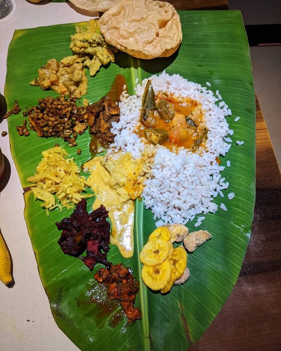 Dish,Food,Banana leaf,Sadya,Banana leaf rice,Leaf,Cuisine,Rice,Andhra food,Ingredient