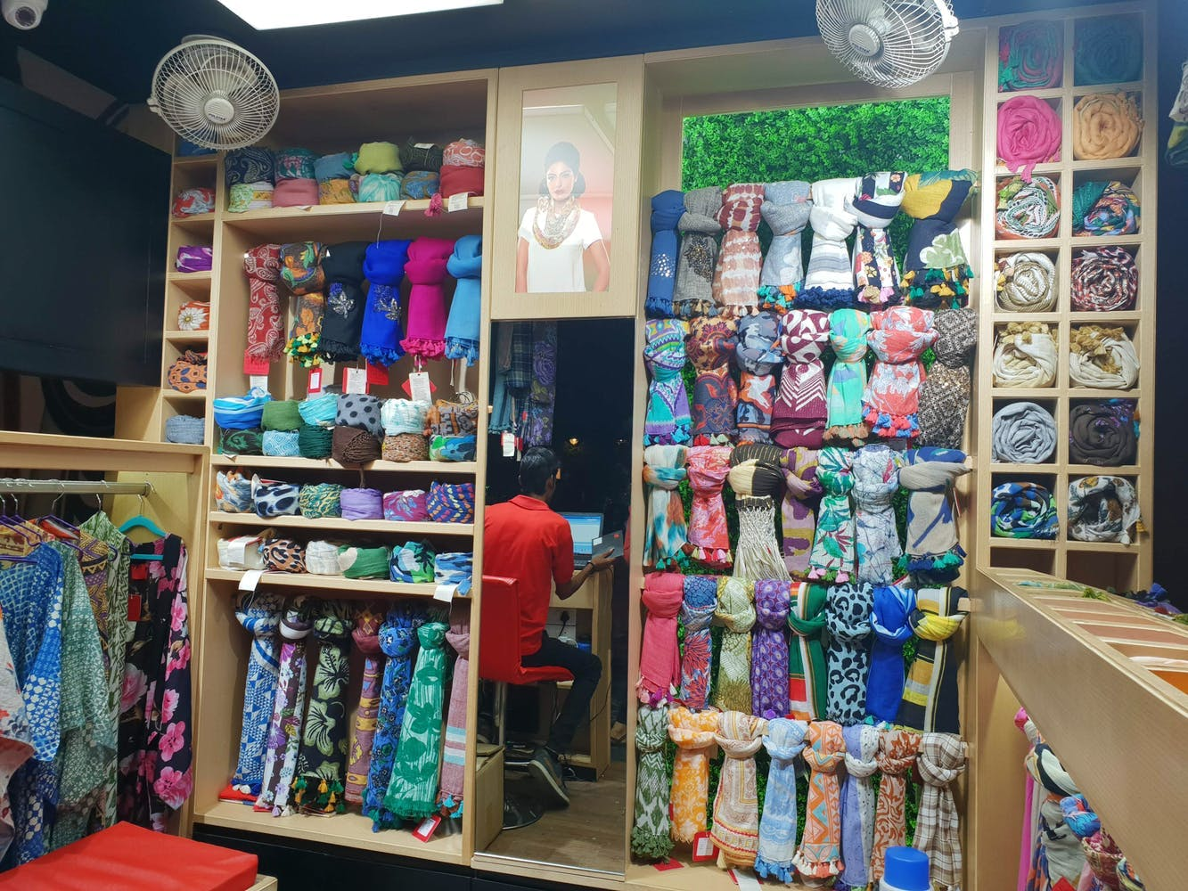 Retail,Room,Collection,Building,Textile,Shelf,Shelving,Bazaar,Interior design,Furniture