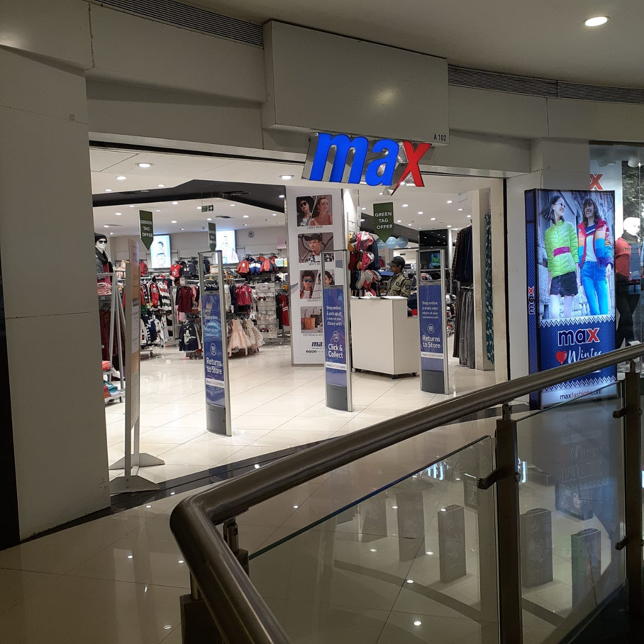 Building,Shopping mall,Retail,Interior design,Door,Outlet store,Machine,Advertising,Airport
