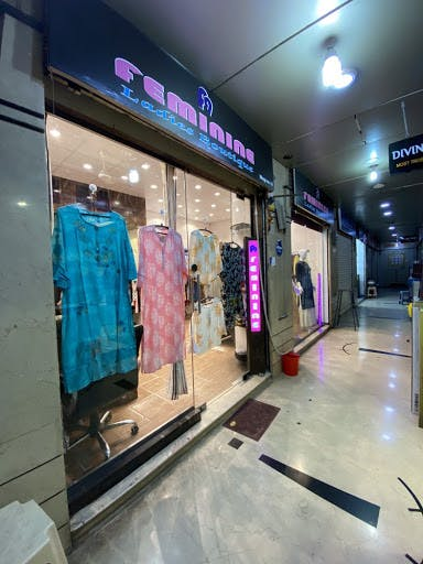 Boutique,Building,Outlet store,Interior design,Ceiling,Floor,Shopping mall,Sportswear,Flooring,Retail