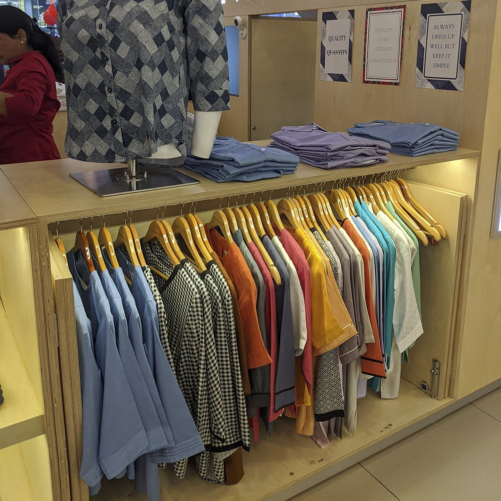 Boutique,Outlet store,Textile,Room,Dry cleaning,Clothes hanger,Furniture,T-shirt