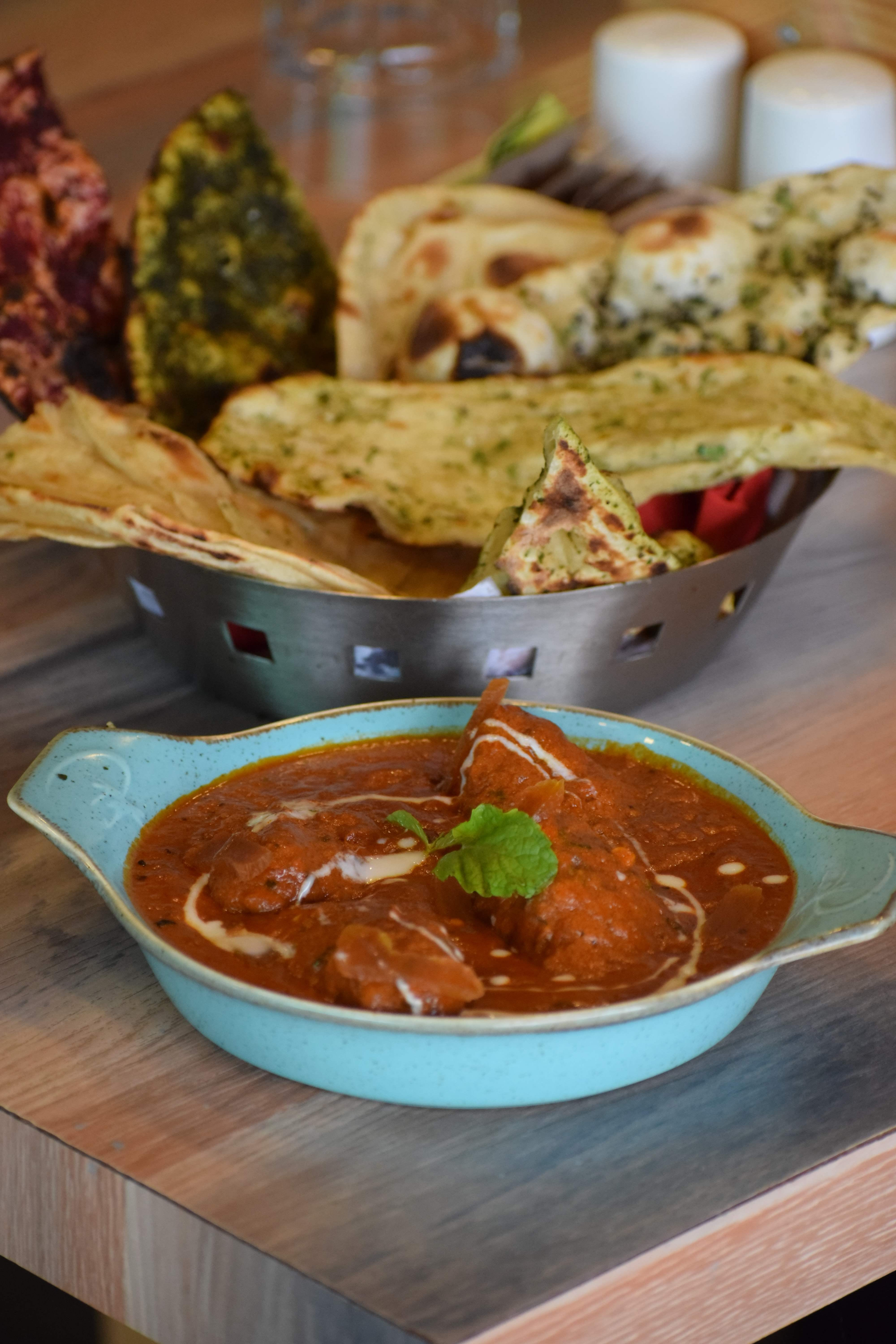 Dish,Food,Cuisine,Ingredient,Tortilla chip,Produce,Naan,Indian cuisine,Curry,Gravy