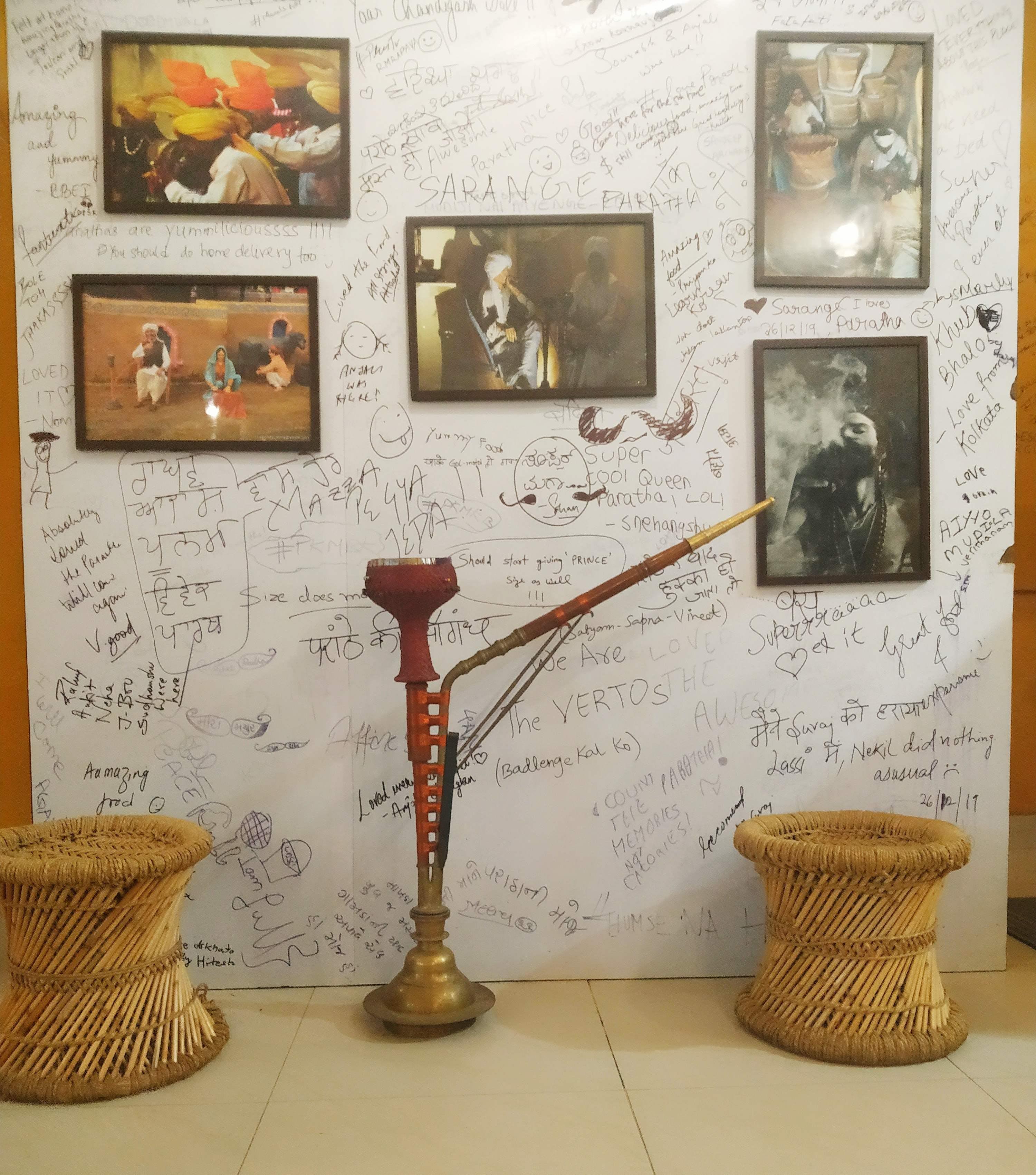 Wall,Floor,Room,Interior design,Art,Table,Tile,Flooring,Furniture,Modern art