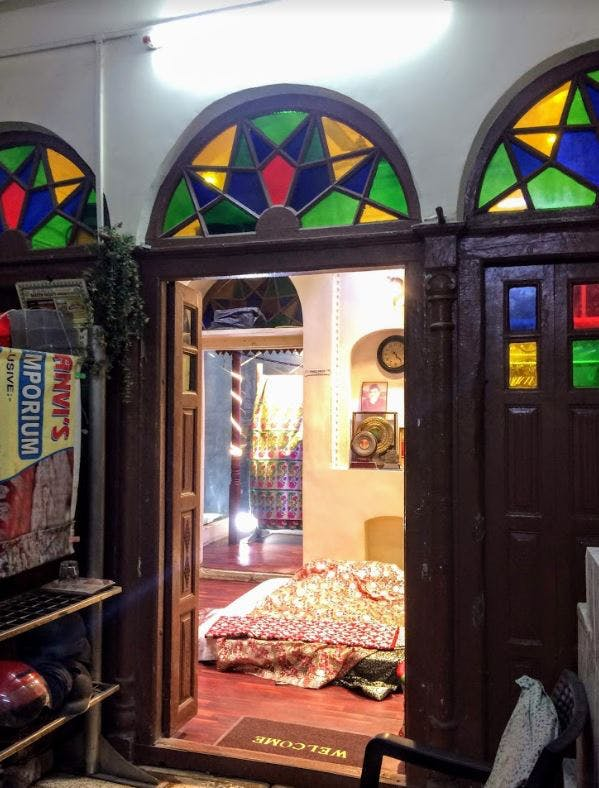 Stained glass,Glass,Arch,Window,Lighting,Interior design,Room,Building,Architecture,Ceiling