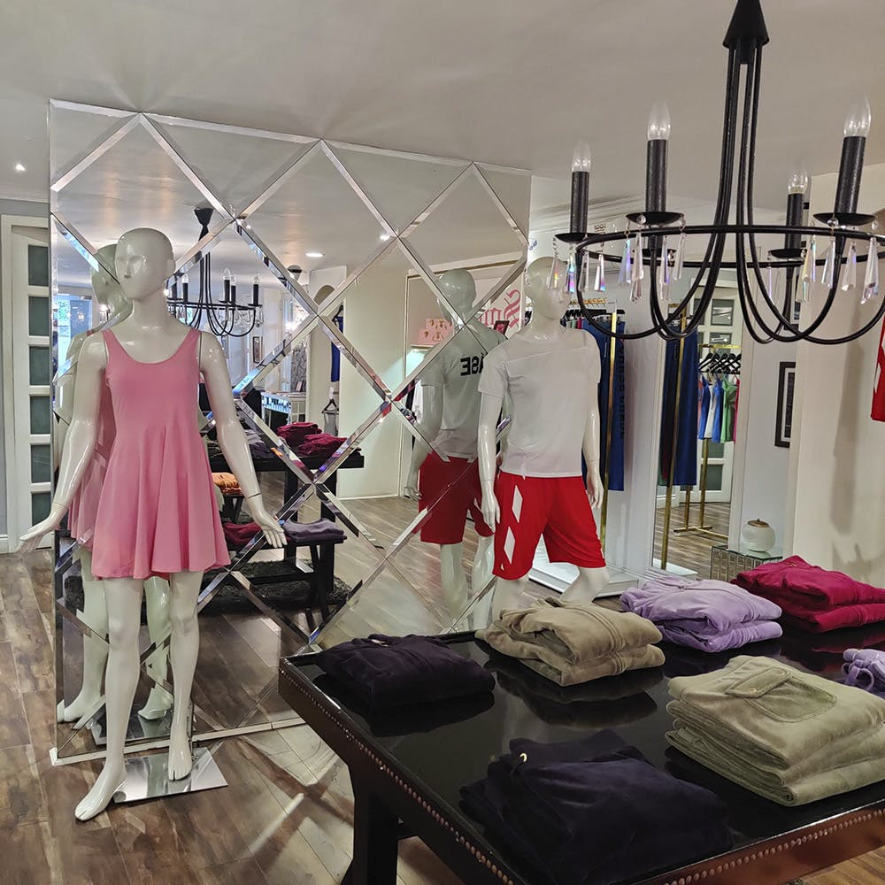 Boutique,Room,Fashion,Interior design,Dress,Furniture,Metal,Building,T-shirt