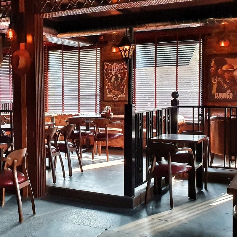 Room,Building,Interior design,Furniture,Restaurant,Table,Door,Architecture,House,Café