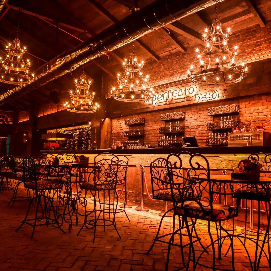 Building,Bar,Restaurant,Room,Architecture,Night,Pub,Table,Furniture,Interior design