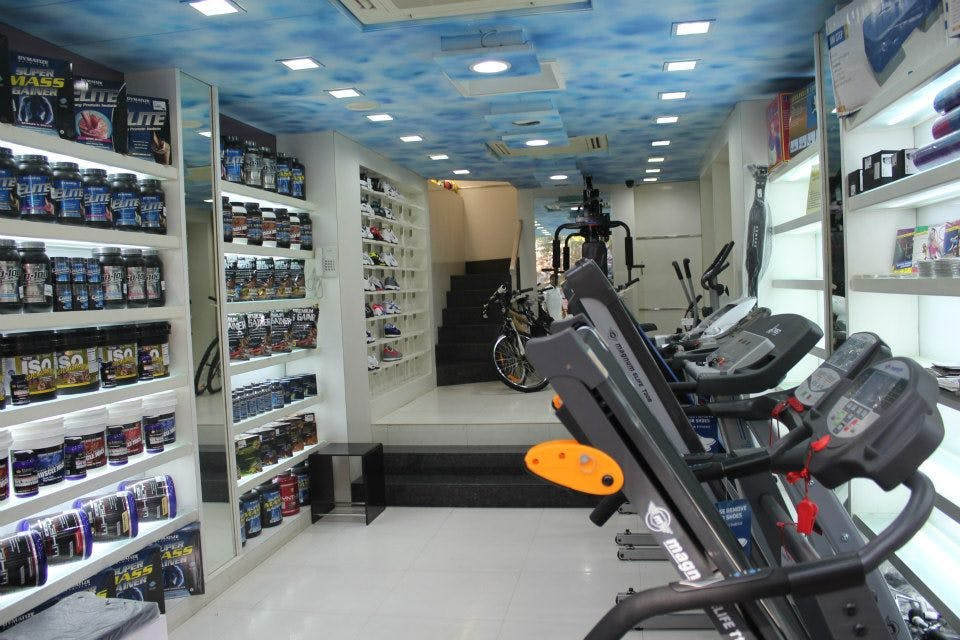 Product,Building,Room,Aisle,Retail,Furniture,Exercise equipment,Shelf,Treadmill,Convenience store