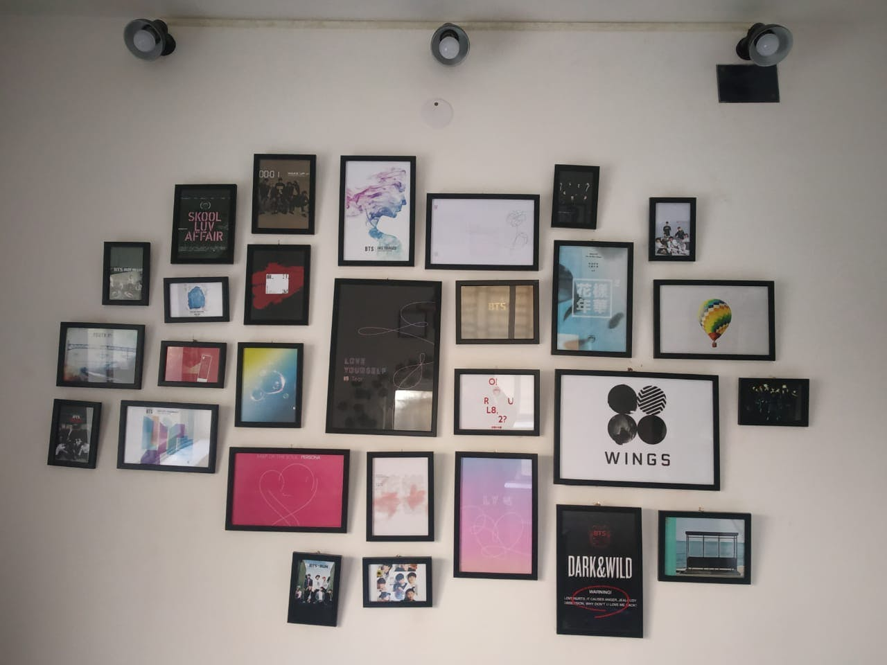 Wall,Collection,Visual arts,Picture frame,Room,Art,Event,Square,Display board,Exhibition