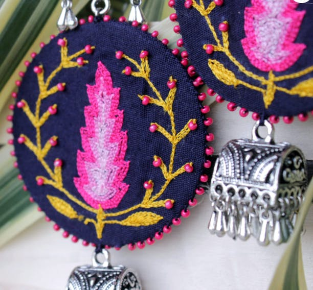 Pink,Fashion accessory,Magenta,Embroidery,Jewellery,Headgear,Feather,Room,Pattern,Plant