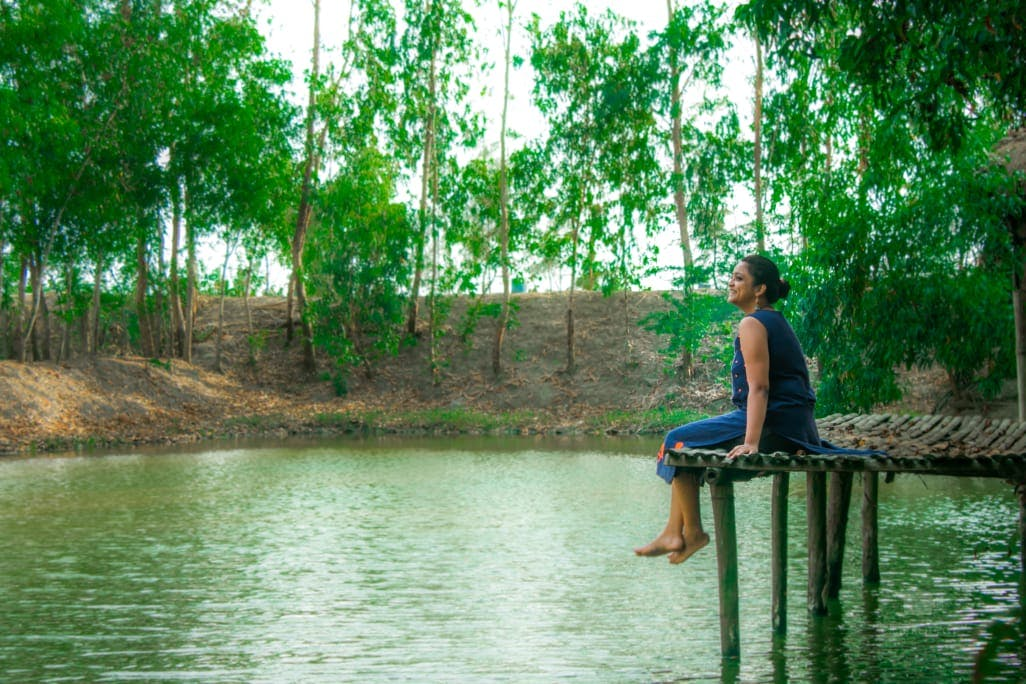 People in nature,Green,Nature,Water,Natural landscape,Pond,Tree,Bank,River,Reflection