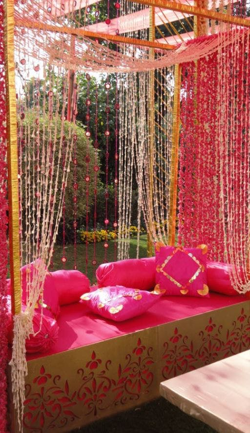 Pink,Decoration,Canopy bed,Room,Interior design,Curtain,Furniture,Textile,Chair,Magenta