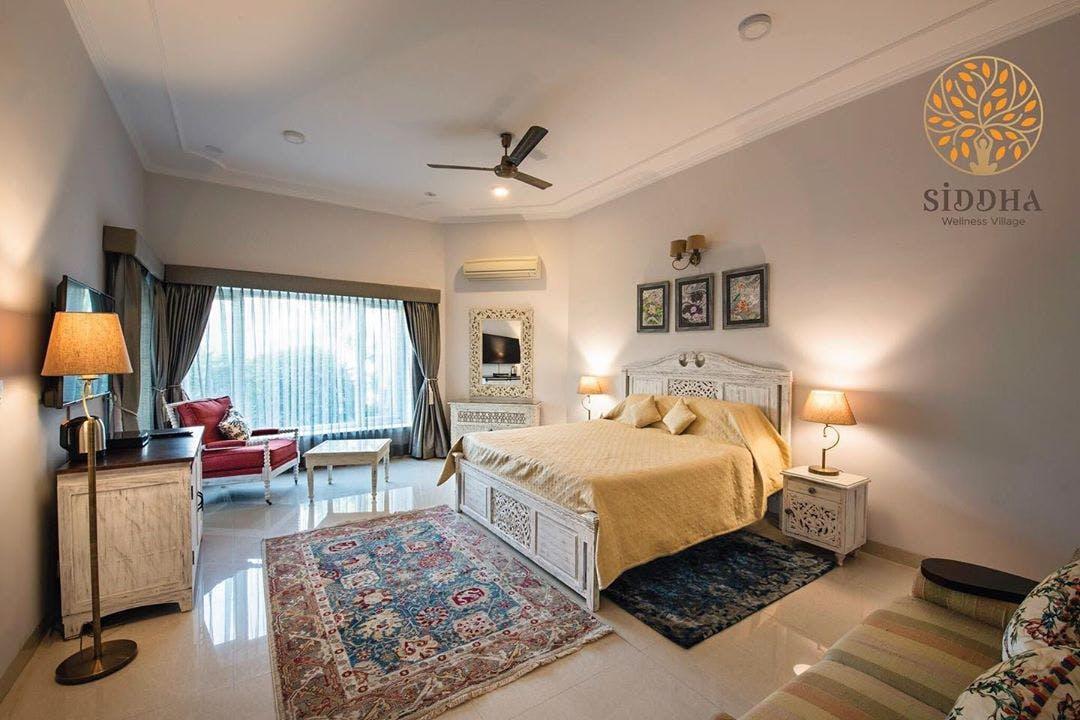 Bedroom,Property,Room,Furniture,Bed,Interior design,Building,Real estate,Bed sheet,Ceiling
