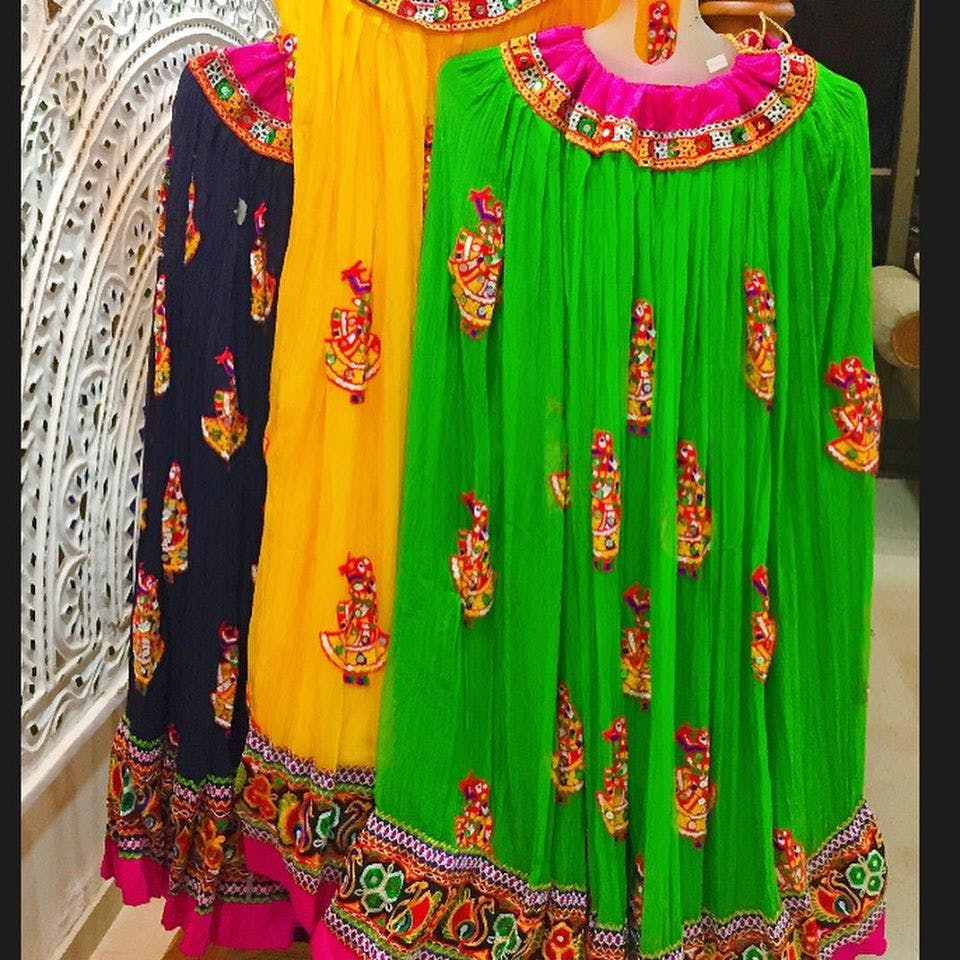 Clothing,Green,Magenta,Embroidery,Yellow,Maroon,Pink,Tradition,Formal wear,Textile