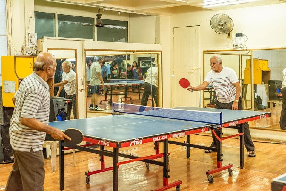 Ping pong,Recreation room,Room,Racquet sport,Table,Sports,Play,Individual sports,Leisure,Indoor games and sports