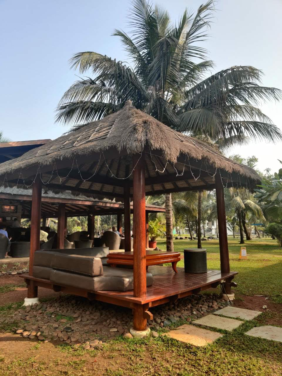 Tree,Gazebo,Palm tree,Arecales,Plant,Roof,Building,Pavilion,Landscape,Outdoor structure