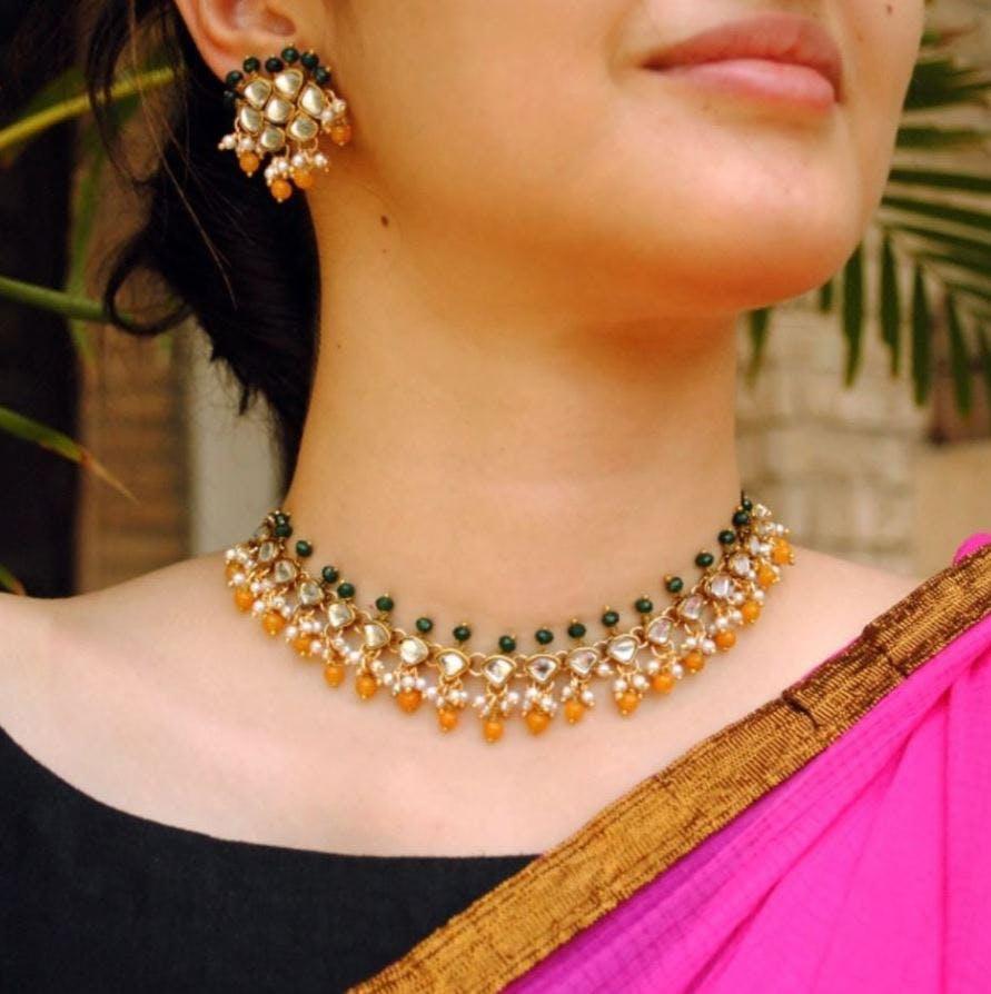 Jewellery,Necklace,Body jewelry,Neck,Fashion accessory,Pearl,Ear,Choker