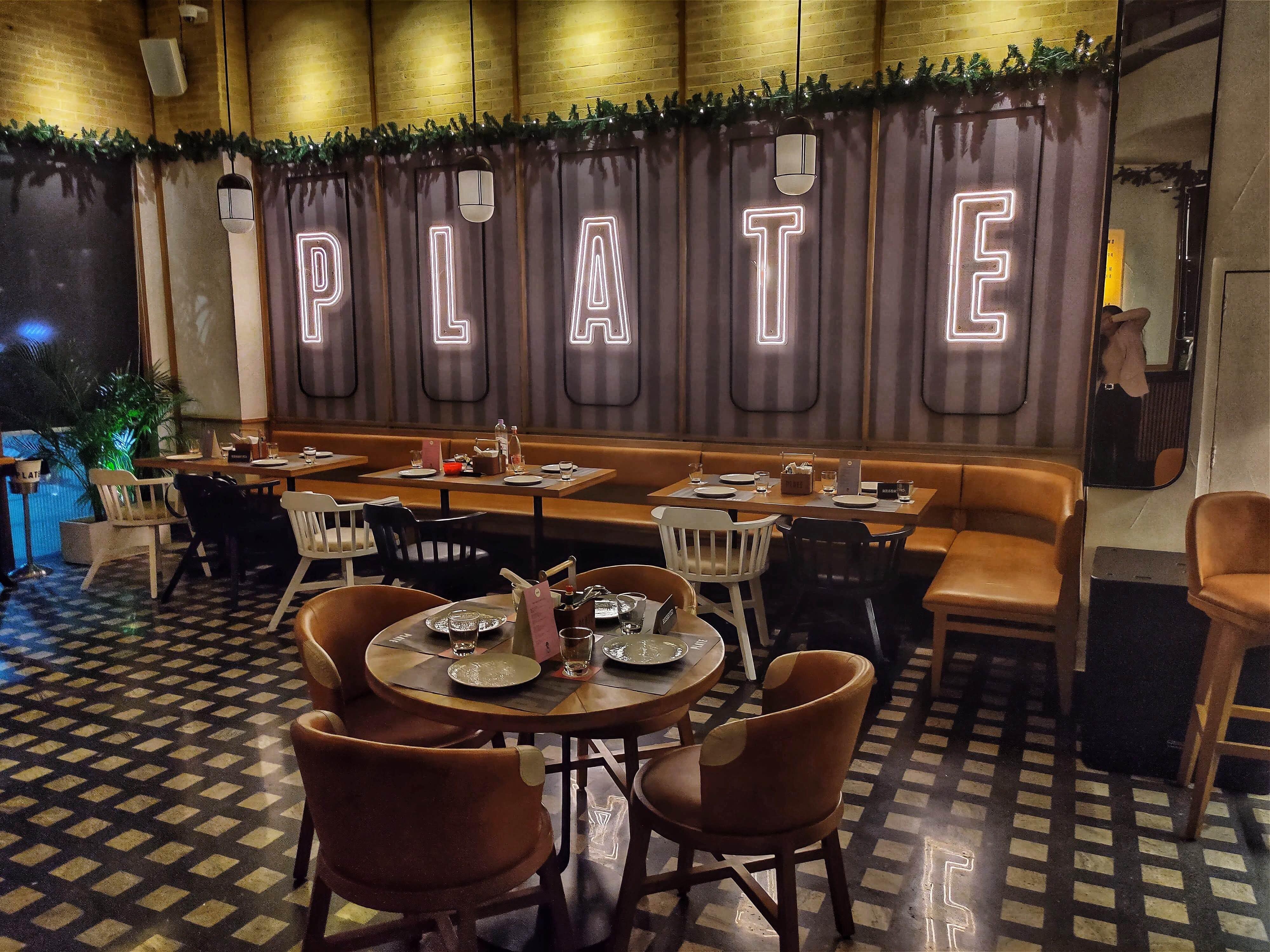 Restaurant,Room,Interior design,Building,Table,Café,Architecture,Furniture,Dining room,House