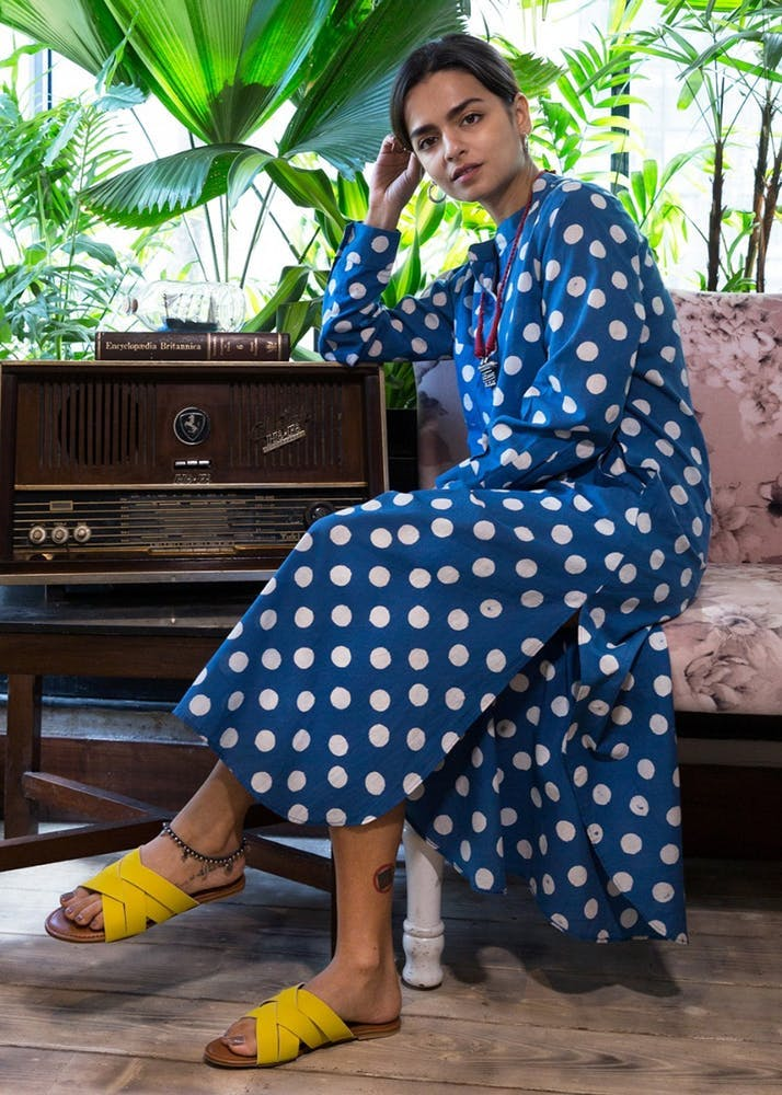 Blue,Polka dot,Yellow,Pattern,Photo shoot,Textile,Leisure