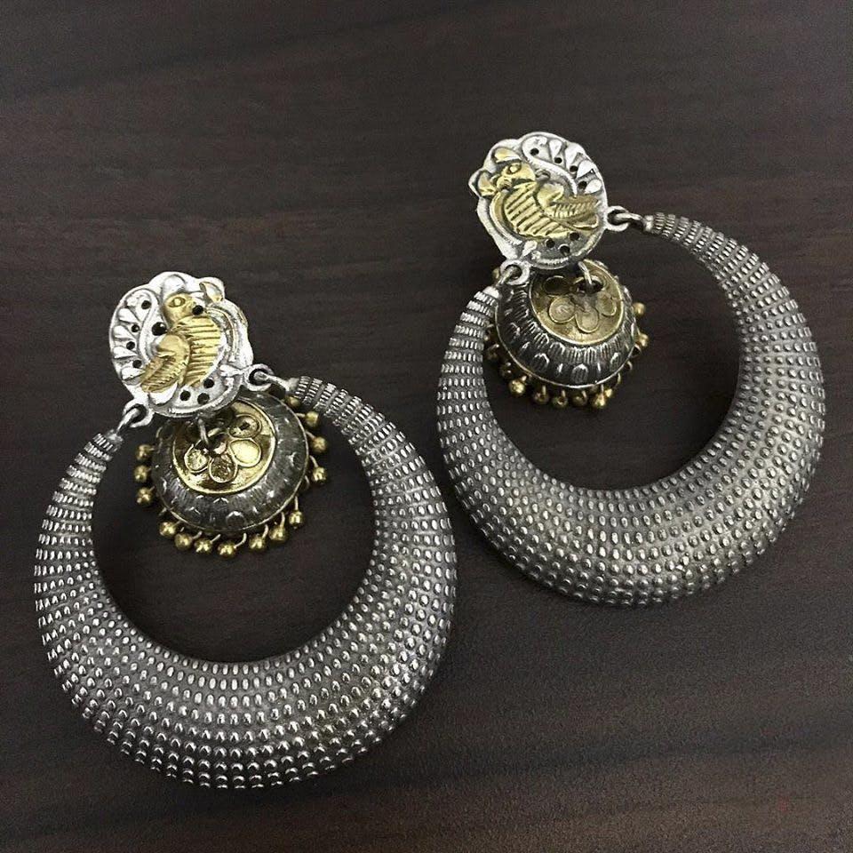 Earrings,Jewellery,Fashion accessory,Diamond,Body jewelry,Silver,Gemstone,Silver,Ear,Metal