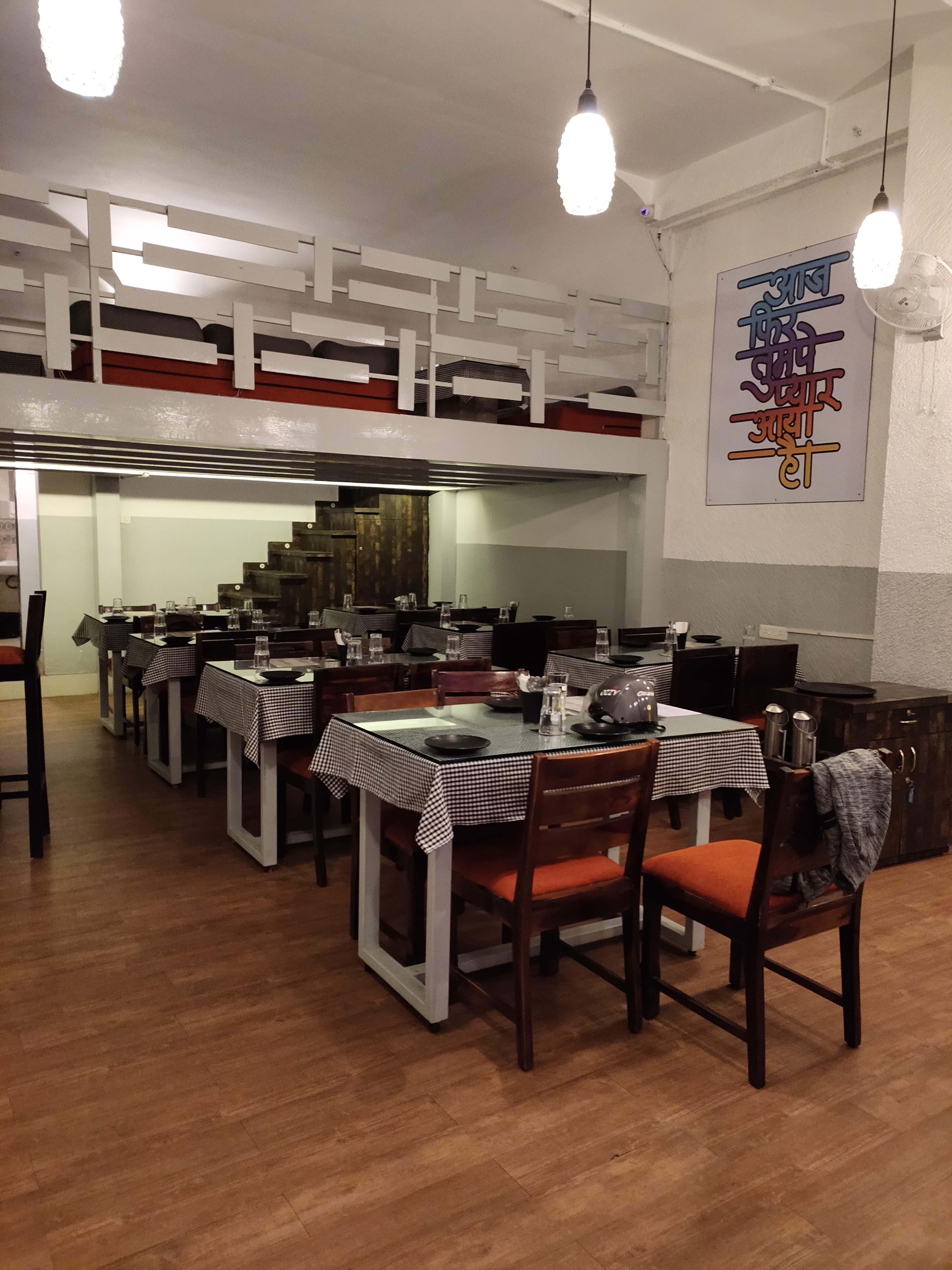 Restaurant,Room,Interior design,Floor,Building,Flooring,Table,Lighting,Cafeteria,Furniture