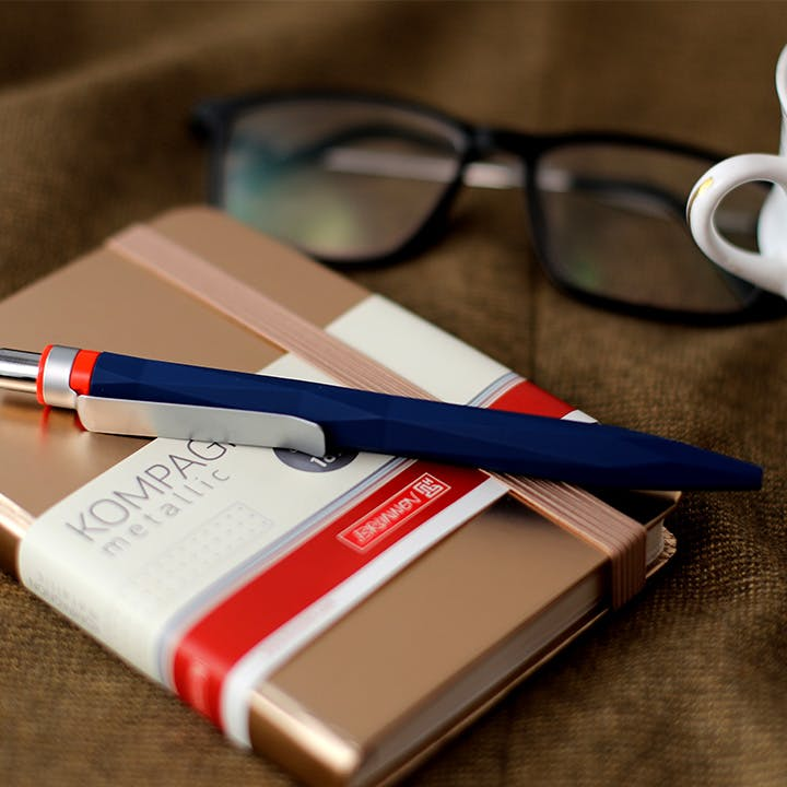 Eyewear,Glasses,Red,Pen,Material property,Vision care,Stationery,Ball pen,Office supplies,Writing implement