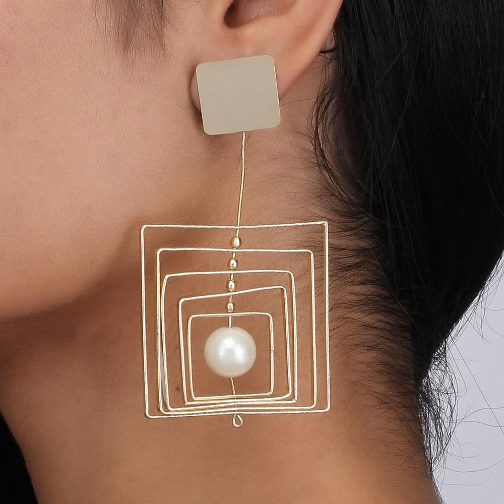 Neck,Skin,Ear,Chin,Nose,Jewellery,Fashion accessory,Mouth,Metal,Earrings