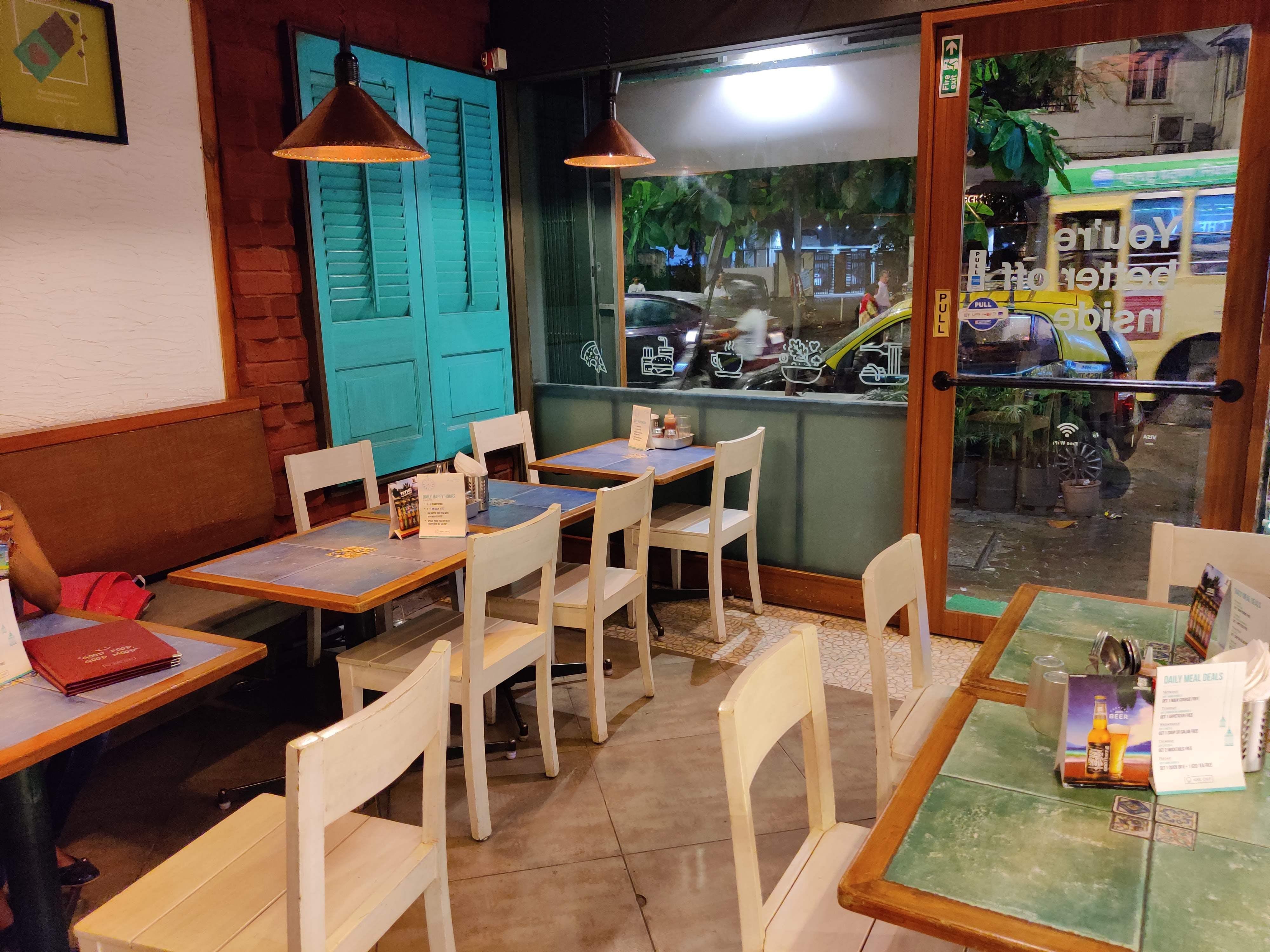 Room,Restaurant,Building,Table,Interior design,Furniture,Café,House,Business,Dining room