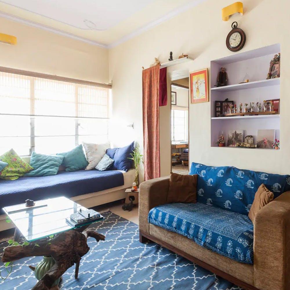 Furniture,Room,Blue,Property,Interior design,Living room,Bed,Floor,Home,House