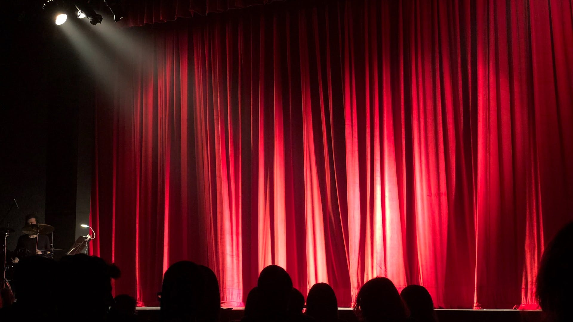 Curtain,Theater curtain,Stage,Theatre,Window treatment,Red,Light,Interior design,Textile,heater