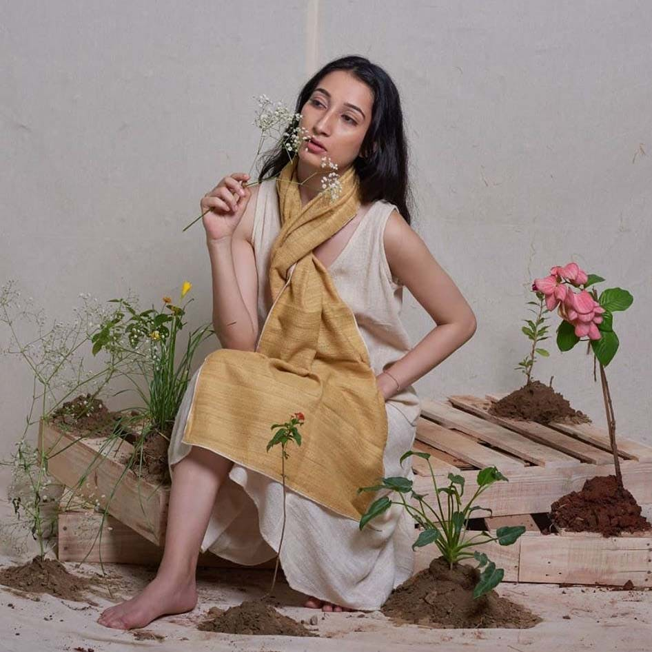 Clothing,Yellow,Pink,Photo shoot,Dress,Formal wear,Peach,Fashion model,Beige,Textile