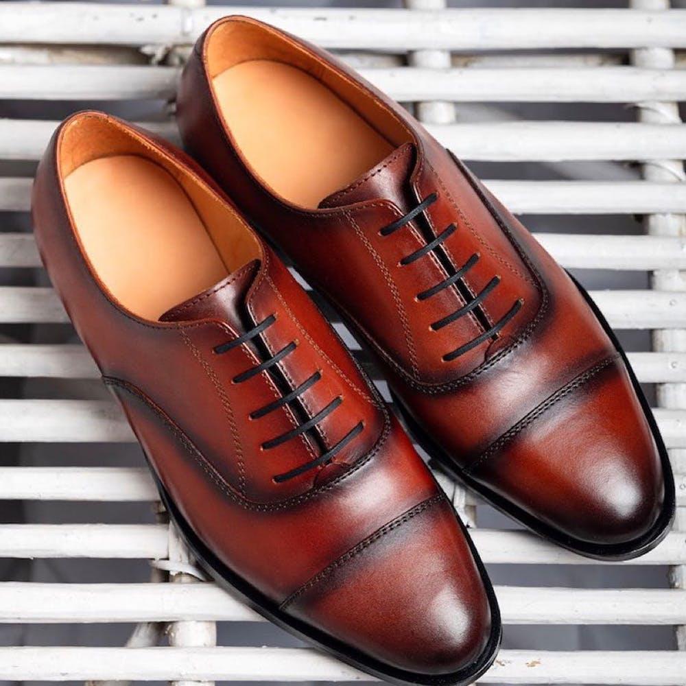 Footwear,Shoe,Dress shoe,Brown,Tan,Orange,Oxford shoe,Leather,Brand