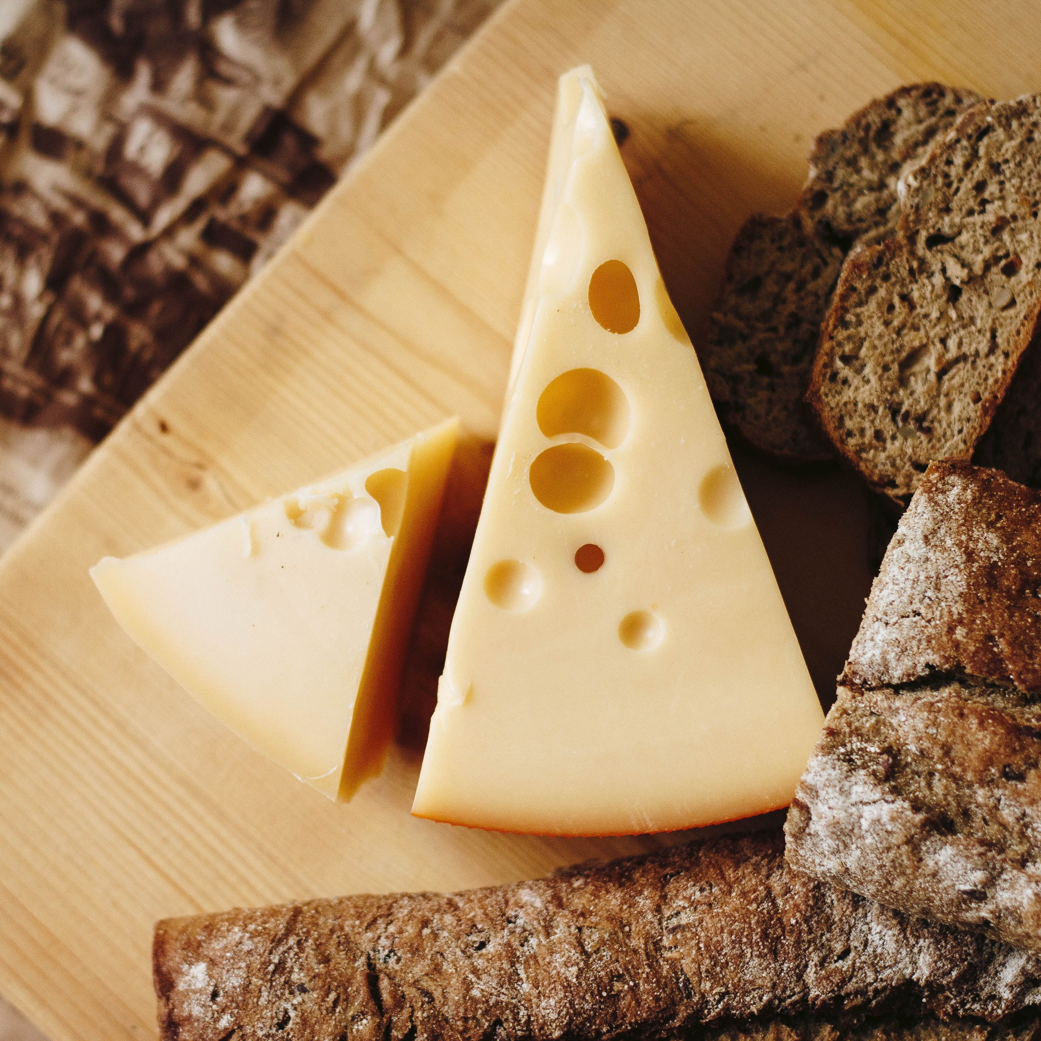 Food,Cheese,Dairy,Comfort food,Ingredient,Cuisine,Swiss cheese,Dish,Cone,Triangle