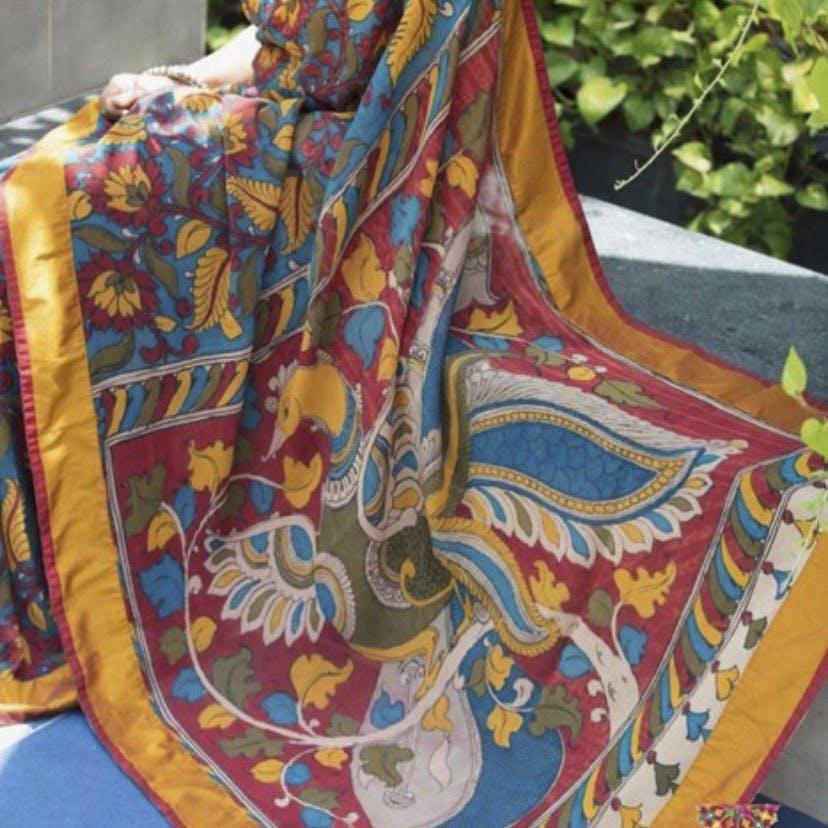 Motif,Yellow,Textile,Visual arts,Bag,Pattern,Fashion accessory,Hobo bag,Paisley,Art