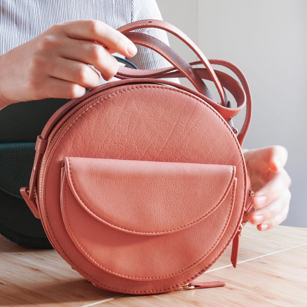 Bag,Leather,Handbag,Fashion accessory,Peach,Hand,Coin purse,Luggage and bags,Backpack