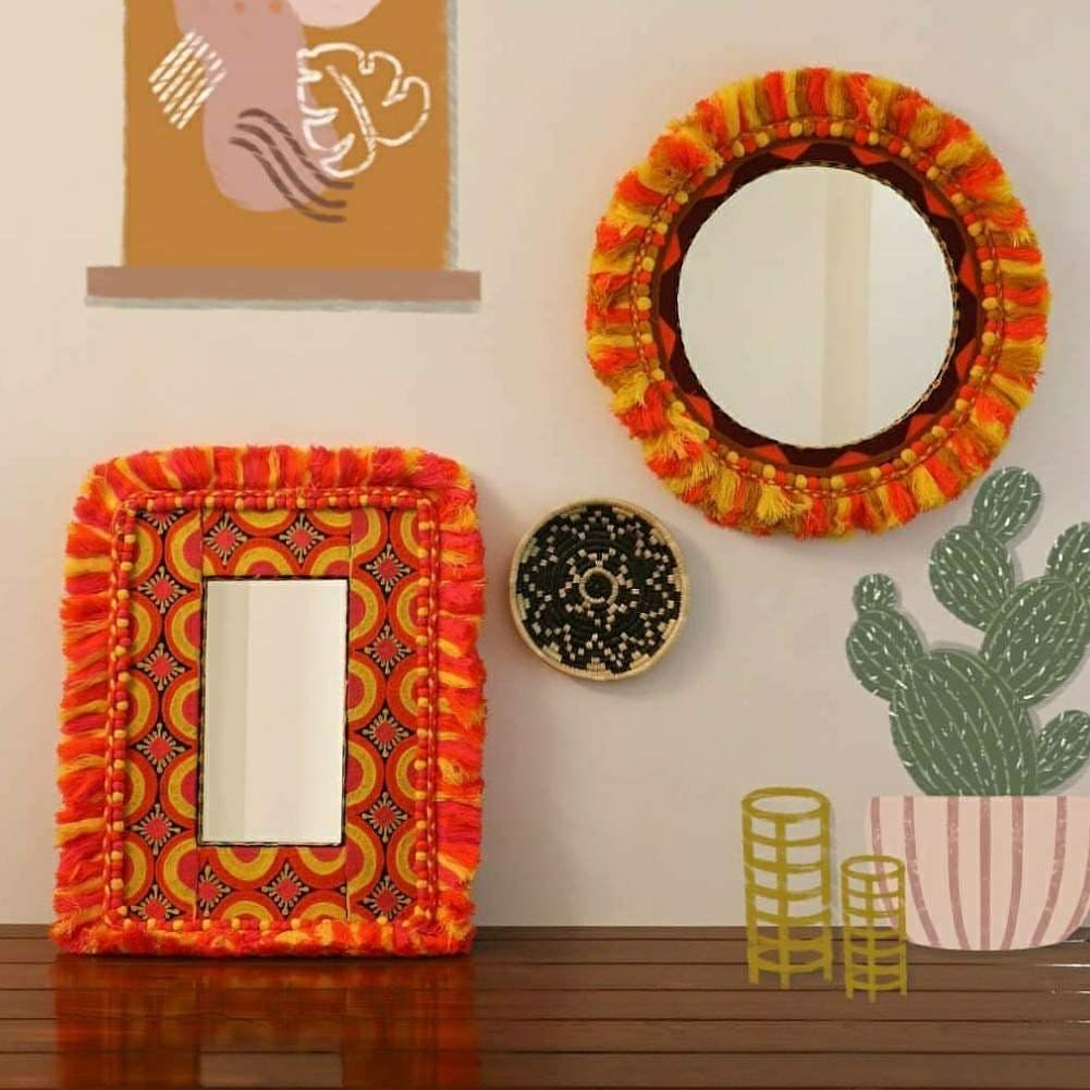 Orange,Textile,Room,Plate,Picture frame,Circle,Rectangle,Table,Pattern,Furniture