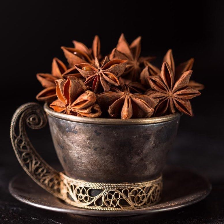 Star anise,Cinnamon,Anise,Spice,Still life photography,Cinnamon stick,Leaf,Plant,Herb,Still life