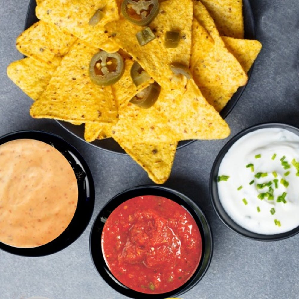 Food,Cuisine,Tortilla chip,Dish,Totopo,Corn chip,Nachos,Ingredient,Dip,Junk food
